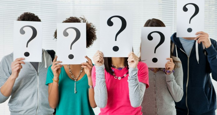 People-Holding-Question-Marks-In-Front-Of-Faces-696x371